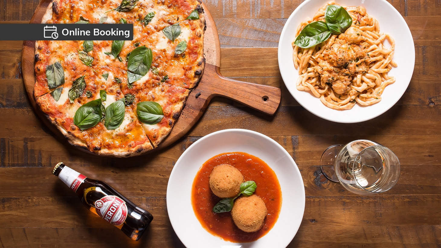 Italian dishes including arancini, pizza and pasta for two served with drinks