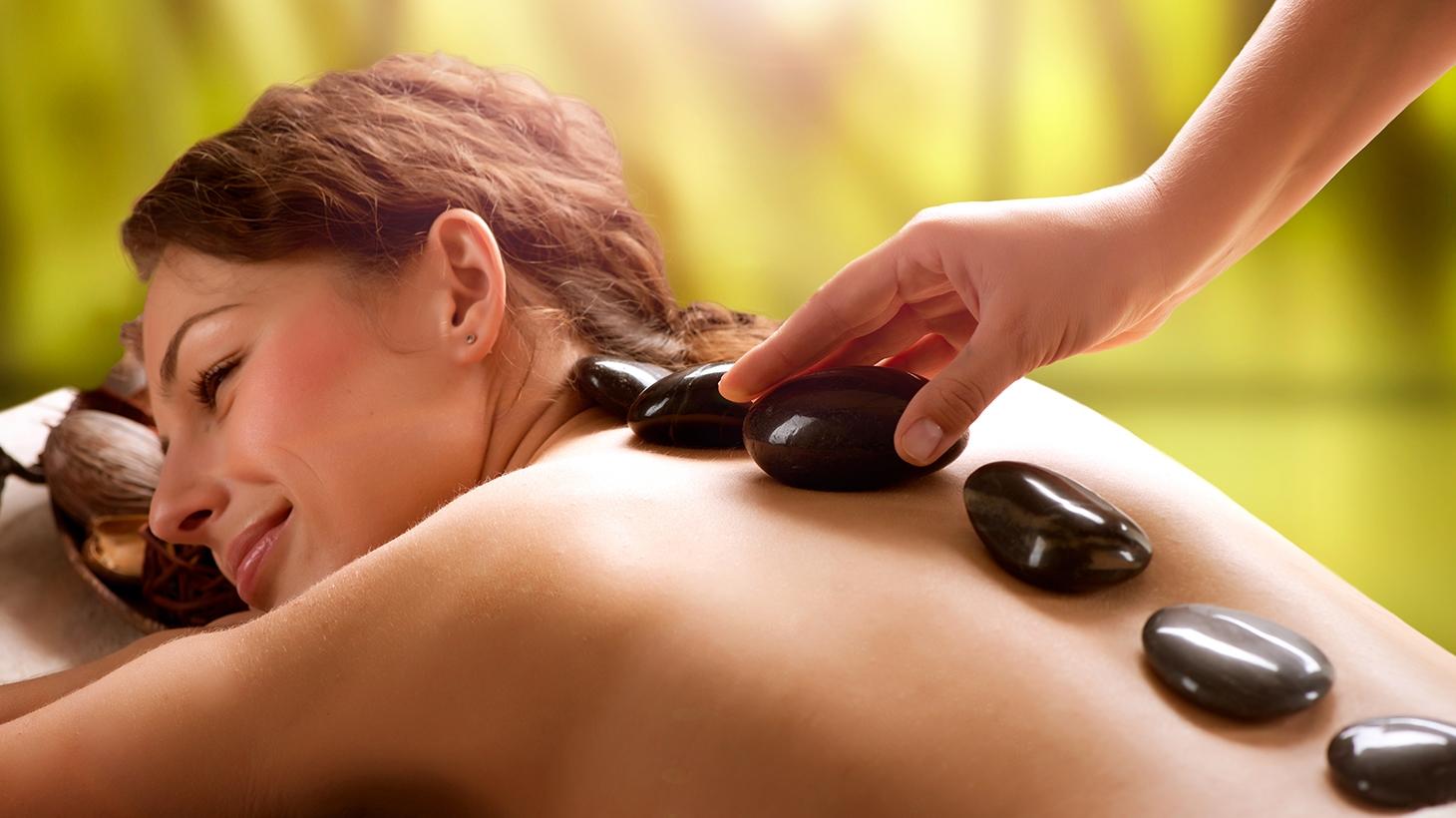 Woman having a hot stone massage
