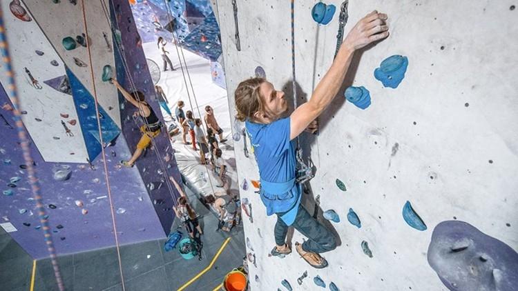 Man indoor rock climbing