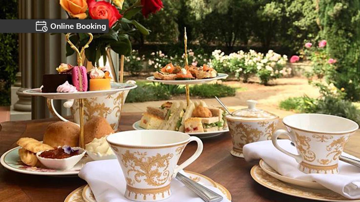 High tea set with assorted sweet and savoury treats