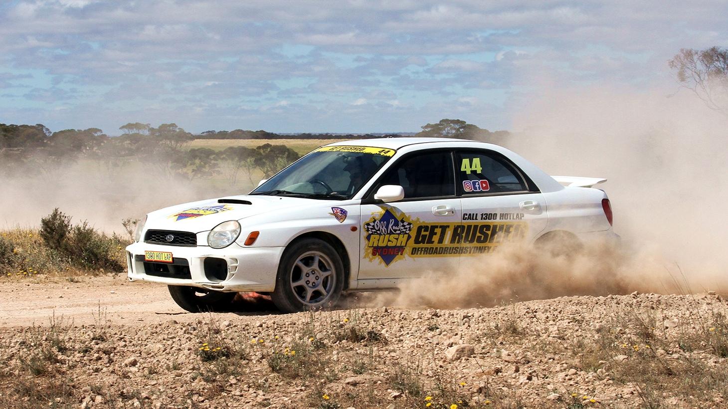 White Turbo WRX rally car whipping around course