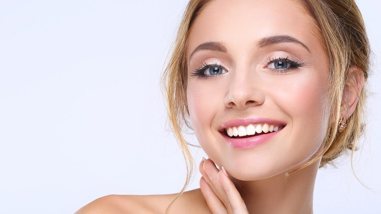 Closeup of woman smiling with clear skin