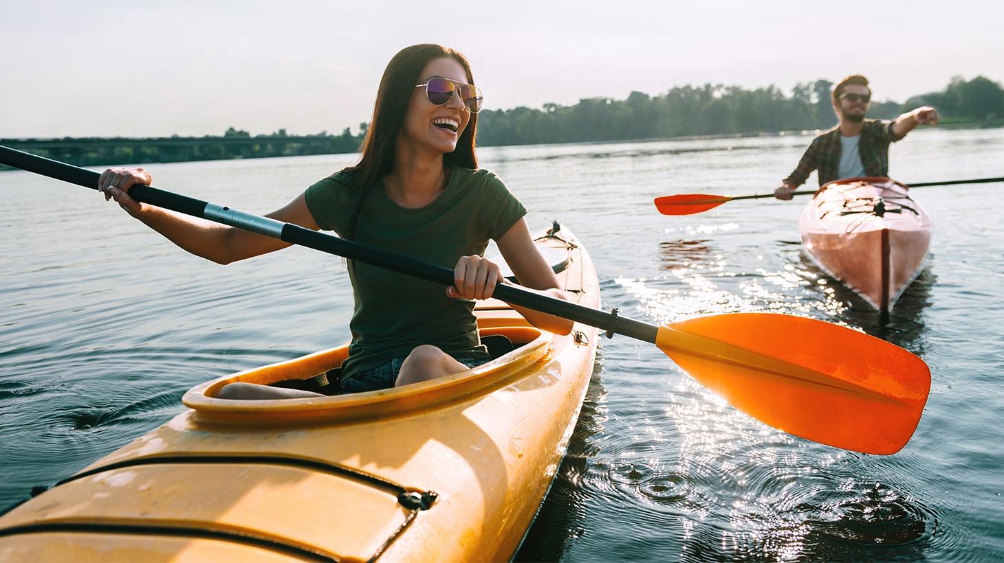 Closeup of woman smiling while kayaking