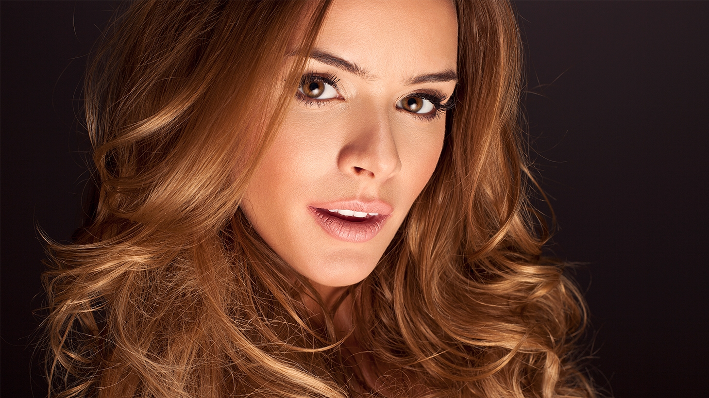 Woman with long wavy brown hair