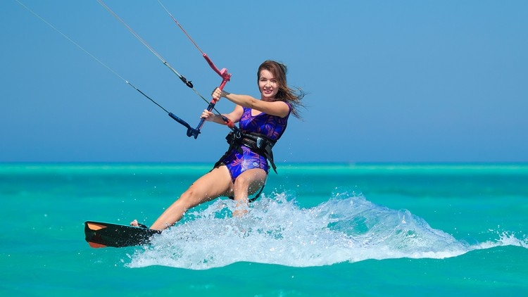 Woman having fun kiteboarding
