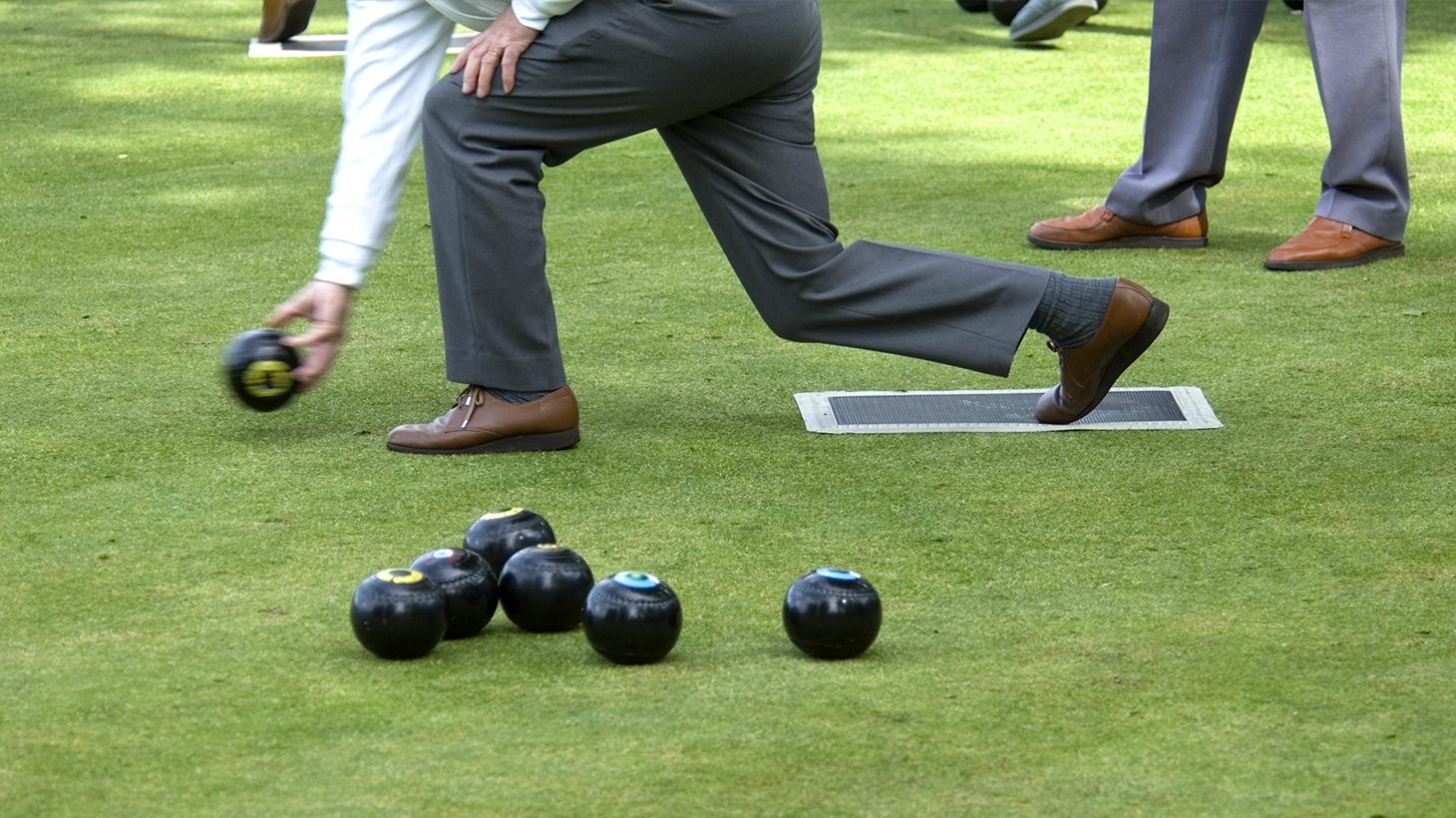 Closeup of man playing lawn bowling