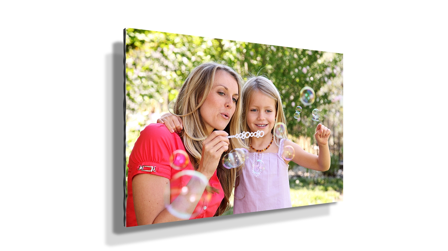 Picture of a mother and daughter blowing bubbles