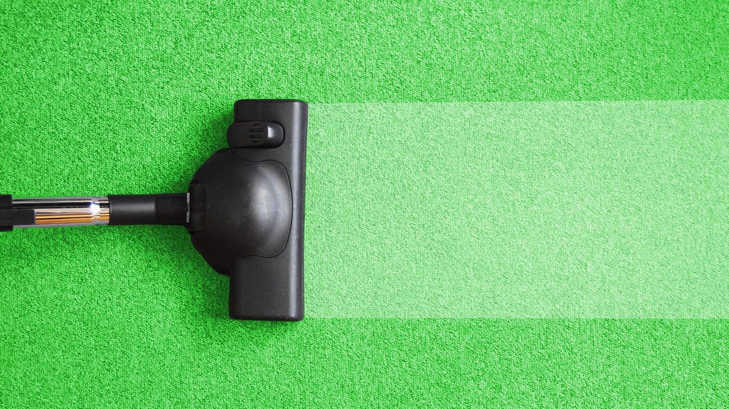 top shot of vacuum cleaning green carpet