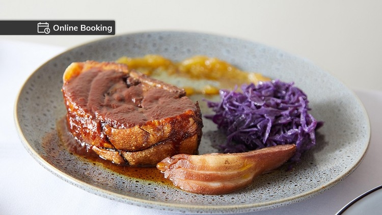 Twice cooked crispy pork belly served with braised red cabbage, poached pear, apple jam and reduction