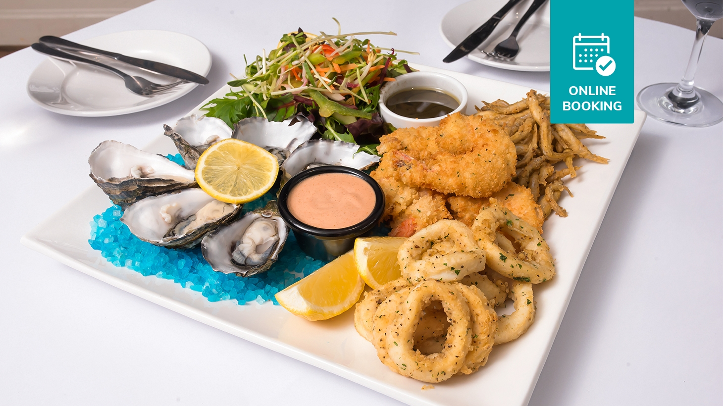 Shared platter for two with 1/2 dozen oysters, whitebait, salt and pepper squid, crumbed prawns and garden salad