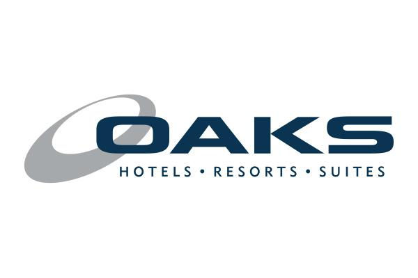 Oaks Cypress Lakes Resort logo