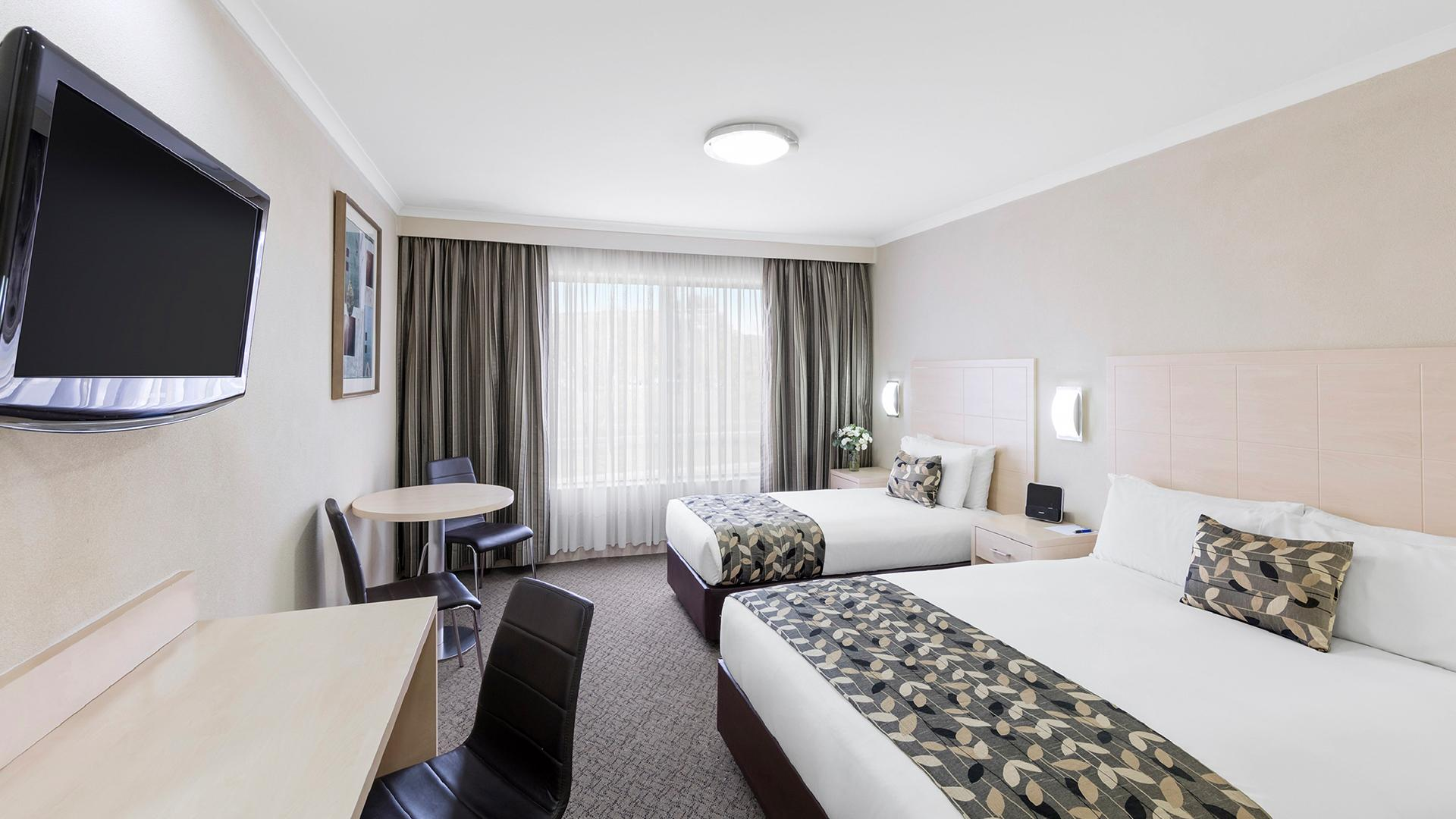 Deluxe Room — Family image 1 at Garden City Hotel, BW Signature Collection by null, Australian Capital Territory, Australia