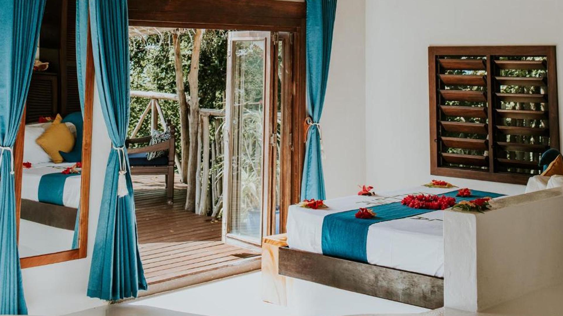 Two-Bedroom Beachfront Bure image 1 at Navutu Stars Resort by null, null, Fiji
